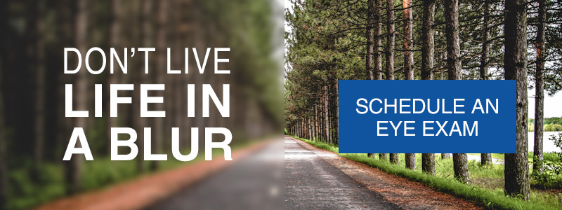 """Image of a road in a forest with the left side blurry and the right side clear. Text over the left side reads """"Don't live life in a blur"""". Text over the right side reads """"schedule an eye exam""""."""